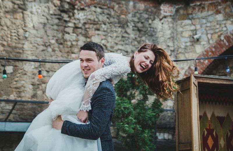 Lifting the Bride on Groom Shoulder